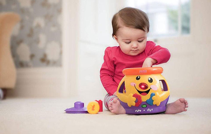 Baby playing with Fisher price cookie shape surprise jar