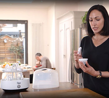 Women reviewing the Tommee Tippee steriliser kit