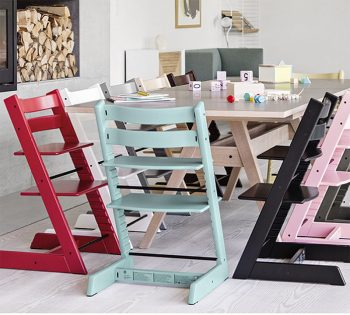 The Stokke Tripp Trapp in various colours around a dining table