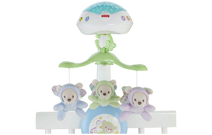 Fisher Price Butterfly Dreams 3 in 1 projection mobile on a cot