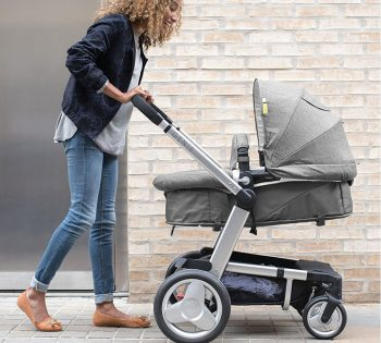 mother pushing baby in Mothercare genie pushchair