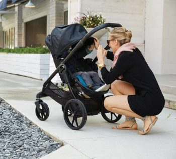 mother- with Baby Jogger City Premier Stroller
